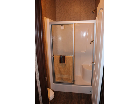 The Homerun also features a full sized shower tucked in the private commode room. This one piece unit with sliding doors provides fast and easy clean up!