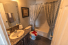 Secondary bathroom for additional bedrooms - great one-piece shower for no-leaks and quick clean up in the Hacienda by Palm Harbor Homes - 4 Bedrooms, 3 Baths, 2338 Sq. Ft.