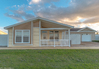 The Summer Breeze IV double wide manufactured home by Palm Harbor Homes in Florida has 2 Bedrooms, 2 Baths, 1,279 Sq. Ft. and 120 square foot built in front porch. Exterior Dimensions: 52'x26'8""
