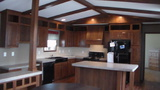 View of Kitchen with oversized island and tons of cabinets