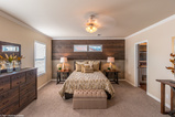 The master bedroom of the Sonora II by Palm Harbor Homes in Round Rock, TX