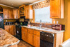 Huge window over the work area in the kitchen of The Bonanza manufactured home by Palm Harbor Homes - 3 Bedrooms, 2 Baths, 1,984 Sq. Ft.  - double wide home