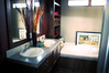 Glamor bath fully loaded with his and hers sinks, soaking tub, stand up shower, and wood shelving!