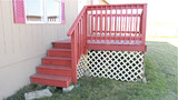 The READY TO MOVE IN home has a functional front porch with easy access and railings for safety