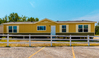 Another exterior view of the Momentum IV MMT364B1 manufactured home with 3 Bedrooms, 2 Baths, 1,984 Sq. Ft. by Palm Harbor Homes