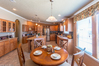 Kitchen with breakfast room in the foreground - The Bonanza Flex by Palm Harbor Homes
