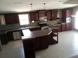 At Palm harbor, we are your source for fabulous wooden cabinets, tile floors and back spashes - Oh My!