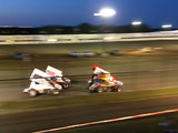 Roaring motors, dirt and a whole lotta family fun - - must be a night of Sprint Car Racing!