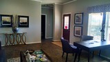 Living room to hall to separate bedrooms. Call Palm Harbor Homes in Huntsville at (936) 344-1685