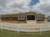 Now introducing the Casa Grande manufactured home by Palm Harbor!  Check out this exterior! Look how thick the trim is and the colors are awesome! This home even has a built-in porch.  4 Bedrooms, 3 Baths, 2520 Sq. Ft.