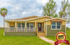 The La Belle VR41764D exterior with beautiful wrap-around porch - Palm Harbor Homes