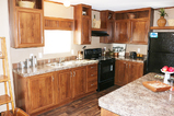 Large Island Kitchen in the double wide Velocity Palm Harbor Homes mobile home.