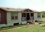 manufactured home with a ladder